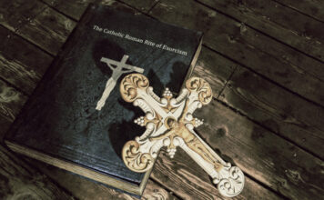 web3-exorcism-exorcist-rite-book-cross-crucifix-shutterstock
